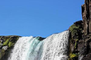 Waterfall under blue sky photo