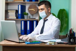 Businessman working with mask on