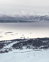 Snow-capped mountains near lake