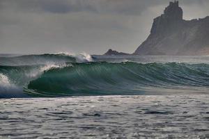 Ocean waves near a cliff