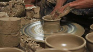 Making clay pot on a potter's wheel video