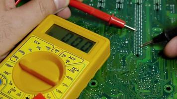 Technician Working Multimeter on Computer