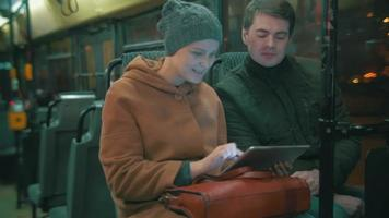 Young people using tablet computer in the bus video