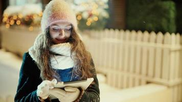 Winter Woman with Tablet Outside in the Snow video