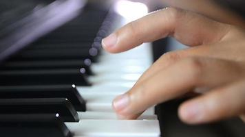 Close up shot shallow depth of field  hands of woman playing piano keyboard press on black and white key video