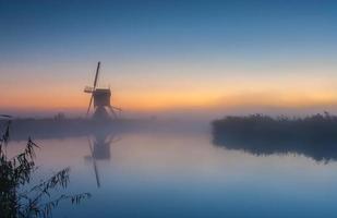 Dutch windmill at sunrise photo