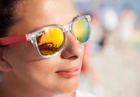 Woman In Sunglasses With Beach Reflection photo