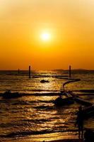 Sunset at the beach on Koh Larn Pattaya Thailand photo