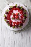 beautiful cake with fresh berries horizontal top view close-up