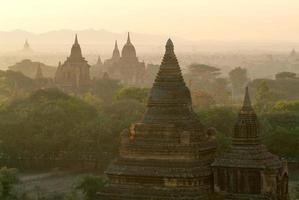 Silhouettes of ancient Buddhist Temples by sunrise at Bagan