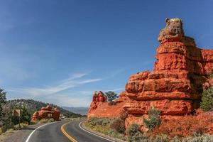 Road through red canyon near Bryce canyon photo
