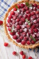 raspberry tart with cream cheese and mint closeup. Vertical top