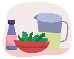 Utensilios de cocina y ensalada en un tazón.