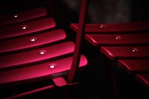 Shallow focus photography of pink metal chairs