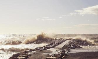 Waves crashing on ocean jetty