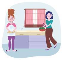 mujeres jóvenes cocinando en la cocina