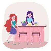 mujeres jóvenes comiendo en la cocina