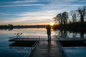 Silhouette of a man at lake