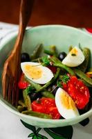 Salad from green beans with olives and egg