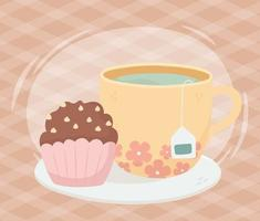 Tea cup with chocolate muffin