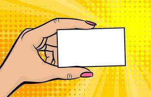 mano de mujer de estilo cómic pop art sosteniendo una tarjeta en blanco vector