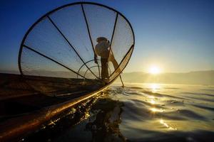 Fishermen in Inle Lake at sunrise, Shan State, Myanmar photo