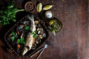 Delicious seabass and mussels, view from above