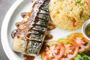Grilled fish with fresh vegetable and rice photo