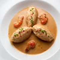 Pike Quenelles with lobster sauce and crayfish tails