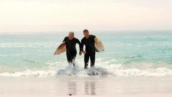 Men with surfboards running