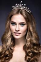 Beautiful girl with a crown in the form of princess.