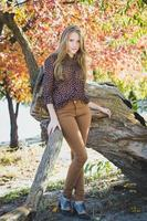 Young beautiful girl in park, full-length portrait photo
