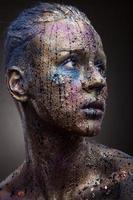 Portrait of woman with unusual solver paint make-up