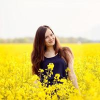 Smiling girl in yellow field photo