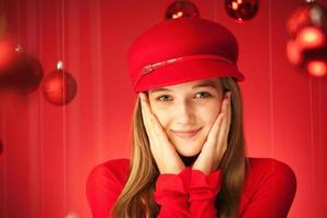 Portrait of Young Girl in Red with Christmas Decoration Theme