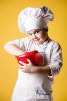 Little boy chef in uniform photo