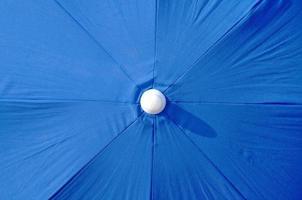 Overview of a blue beach umbrella