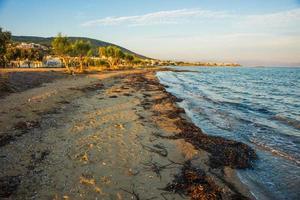 Seafront and beach near  town of Scala, Agistri Island,  Grece