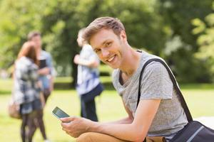 Handsome student studying outside on campus photo