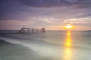 Silhouette of fisherman jetty during sunrise photo