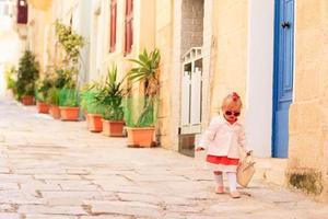 cute little girl walking on the street of Malta