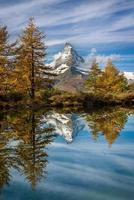 Reflection of Matterhorn in late Autumn, Switzerland photo
