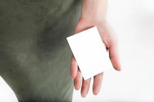 Woman holds white card in her hand