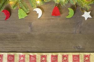 Top view of Christmas decor on wooden table