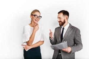 Cheerful business partners dressed in office attire on white background