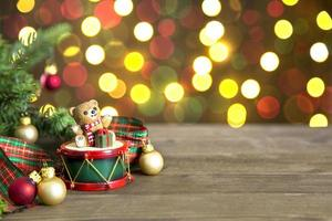 Christmas decor on table with bokeh lights