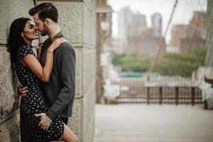 Attractive couple embraces in the city