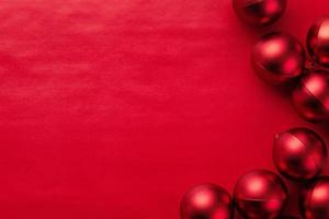 Red baubles on red background