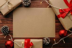 Kraft paper surrounded by Christmas decor