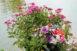 Bunch of flowers near lake water